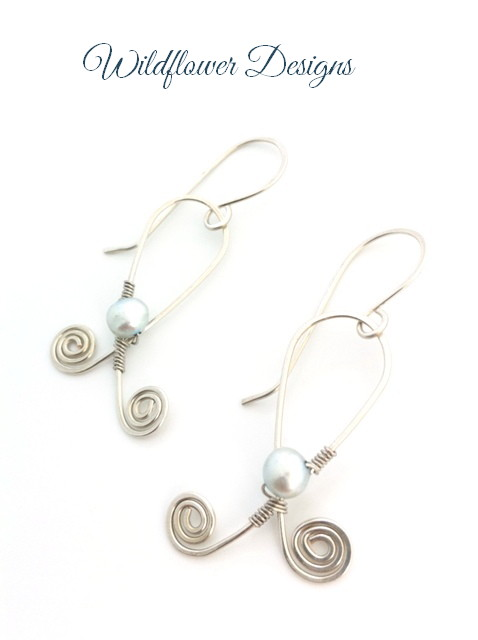 earrings freshwater pearls wire wrapped to silver wire swirls
