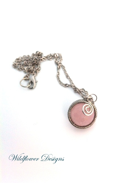 rose quartz wire wrapped necklace on silver chain