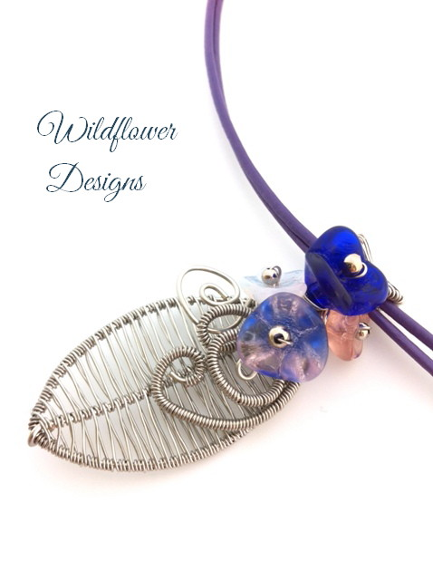 Wire woven leaf necklace with flower cluster