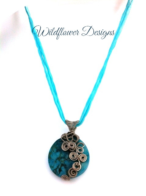 turquoise jasper focal pendant with silver wire swirls and silk cord