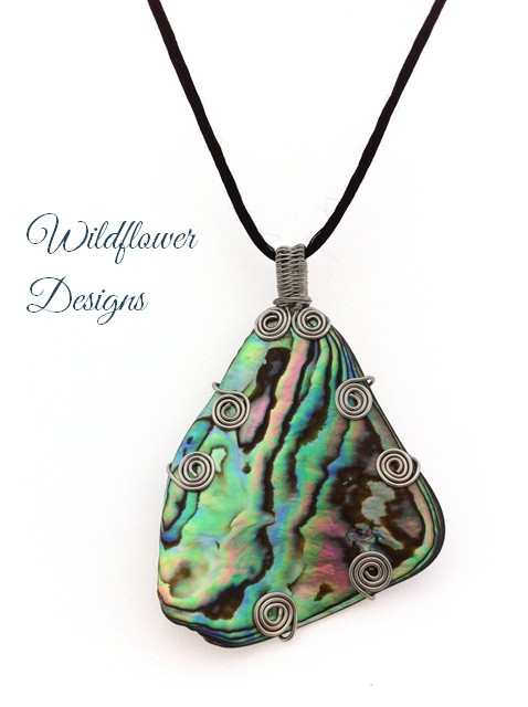paua feature with silver wire swirls on satin cord