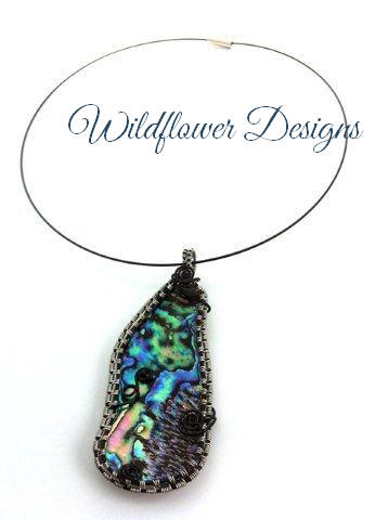 paua pendant framed with black and silver wire wrap