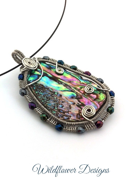 wire woven framed paua pendant with fire polished beads