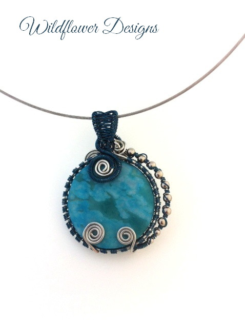 turquoise jasper coin with deep teal and silver wire wrap