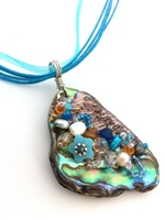 Embelllished Paua Pendant - Aqua and Orange on aqua organza and cord necklace