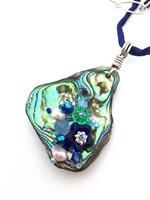 Embelllished Paua Pendant - Blues and pale Teals on deep blue silk string
