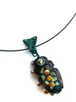 Lampwork Black/Teal/Metallics with teal wire woven bail on black neckwire