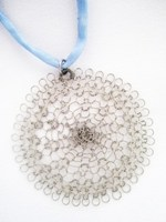 Silver Flower Pendant on Light Blue Silk Cord