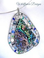 Wired Paua Pendant Embellished with blues and greens