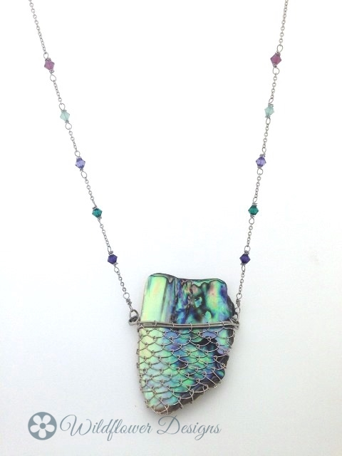 Laced Paua with green/purple crystals