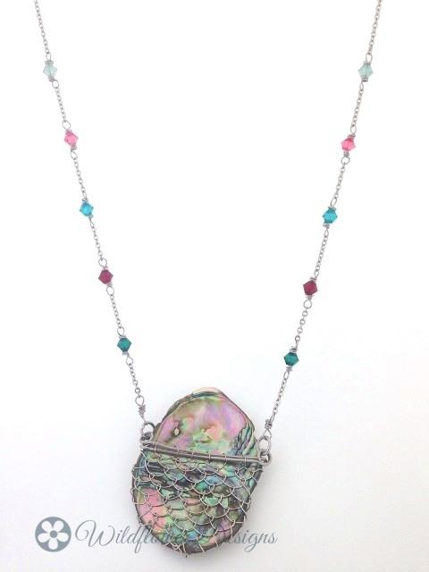 Laced Paua with aqua/pink crystals