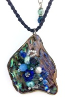 Embelllished Paua Pendant - Blues/Teals on blue braided waxed cord