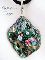 Embelllished Paua Pendant - Emeralds and Orange/copper on satin Rattail cord