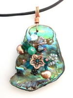 Embelllished Paua Pendant - Teal and copper oranges on black leather cord